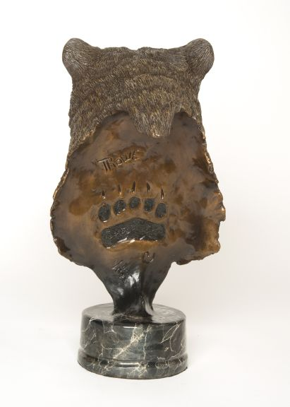 The bronze 'The Legend' depicting a bear's head and upper neck. (rear view)