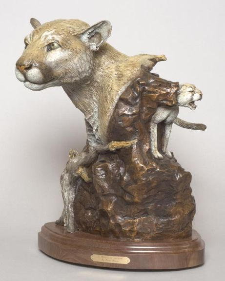 The bronze 'A Mountain Shadow' depicts a mountain lion.