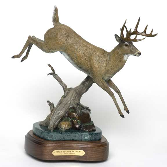 A deer leaps over old limbs and rocks in the bronze 'River Bottom Retreat'