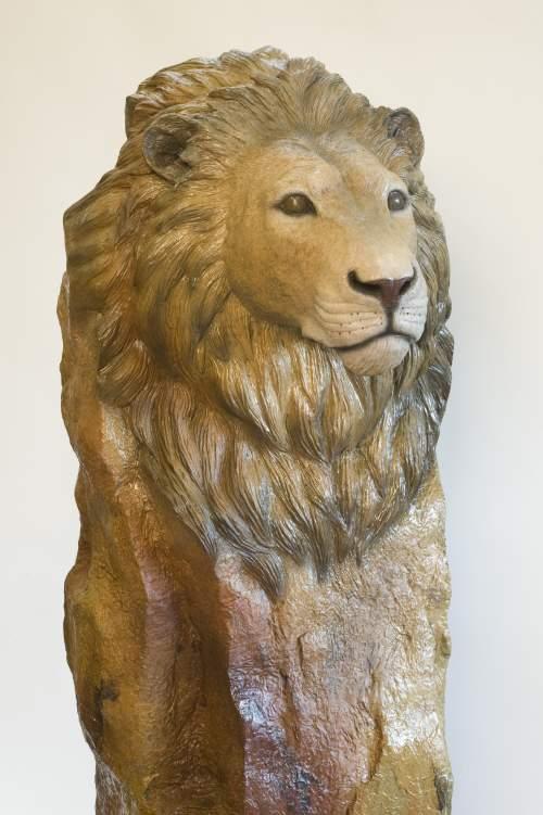 The bronze sculpture 'Serengeti Sunset' of a lion bust.