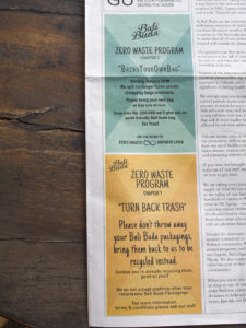 Showing the announcement of Bali Buda in their newspaper/menu to not give any plastic bags anymore and to take back packaging for recycling