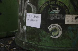 """Love rather than consume"" - Message on glass collection container in Berlin. Plastic waste collected and recycled."