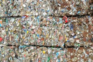 Pressed and stacked PET bottles. Plastic waste collected and recycled?