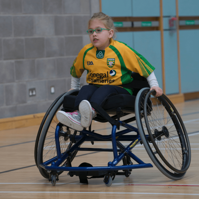 Student in wheelchair in gym