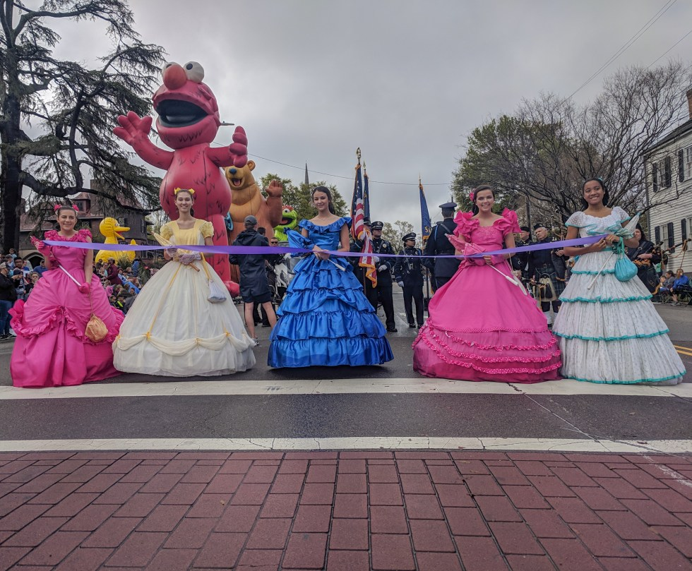 Azalea Belles leading the parade before the ribbon cutting