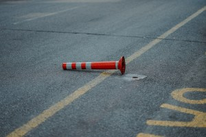 orange road construction cone in road