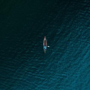 man in boat on ocean