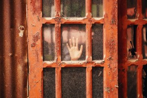hand on frosted glass