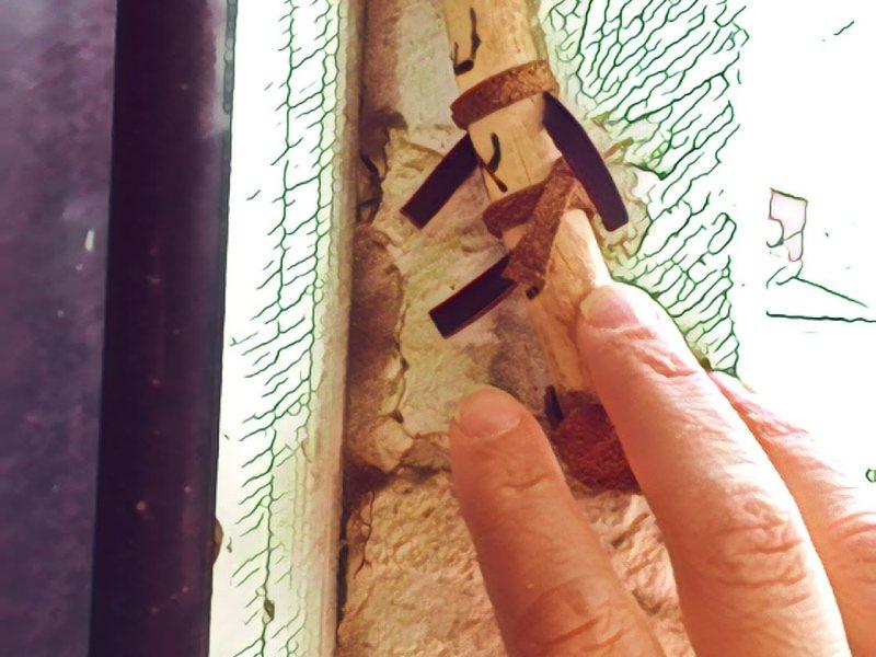 Hand touching a mezuzah