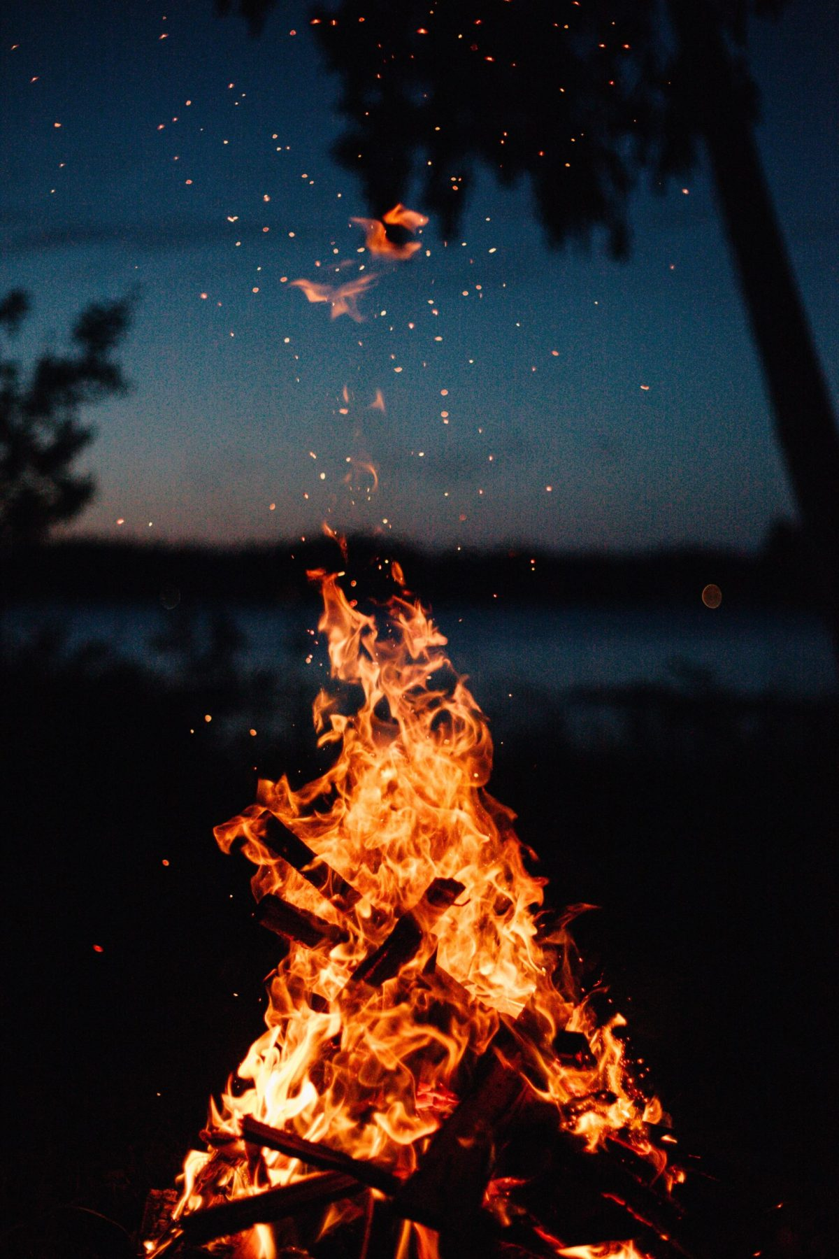 Roaring bonfire, with fading light on the horizon
