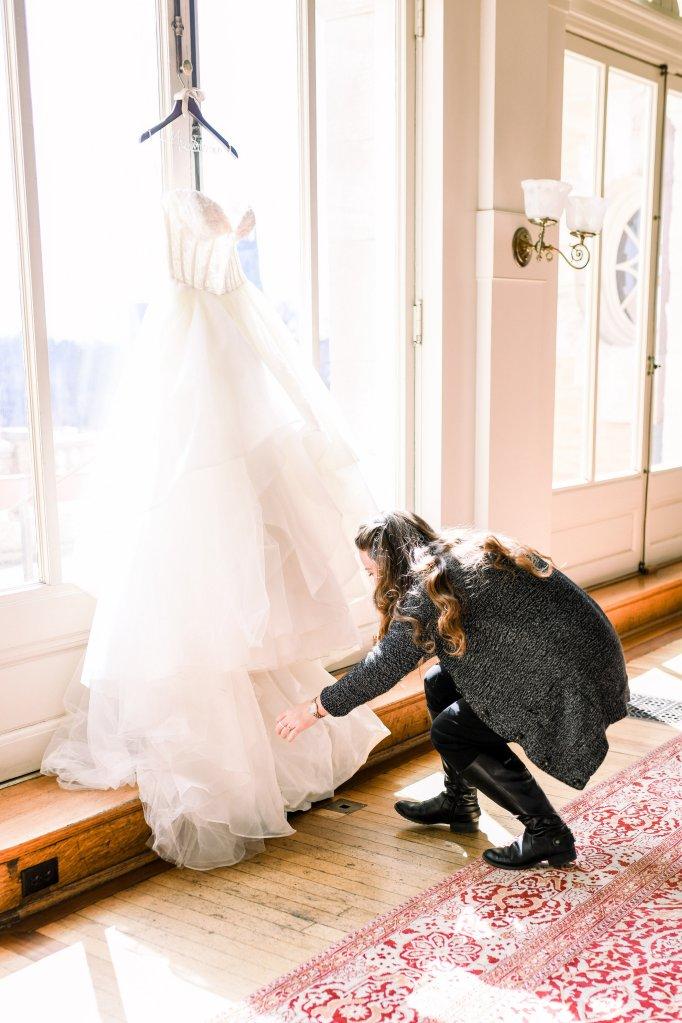 wedding planner fixing dress