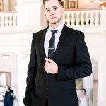 groom wearing calvin klein suit