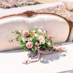 vintage sofa with wedding bouquet