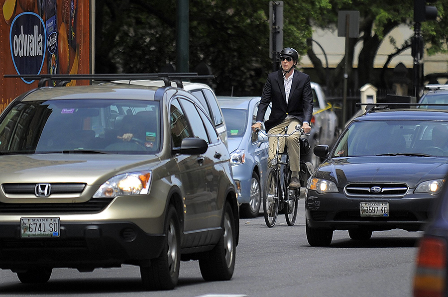 A bicyclist makes his way through traffic on Congress Street. Press Herald file photo