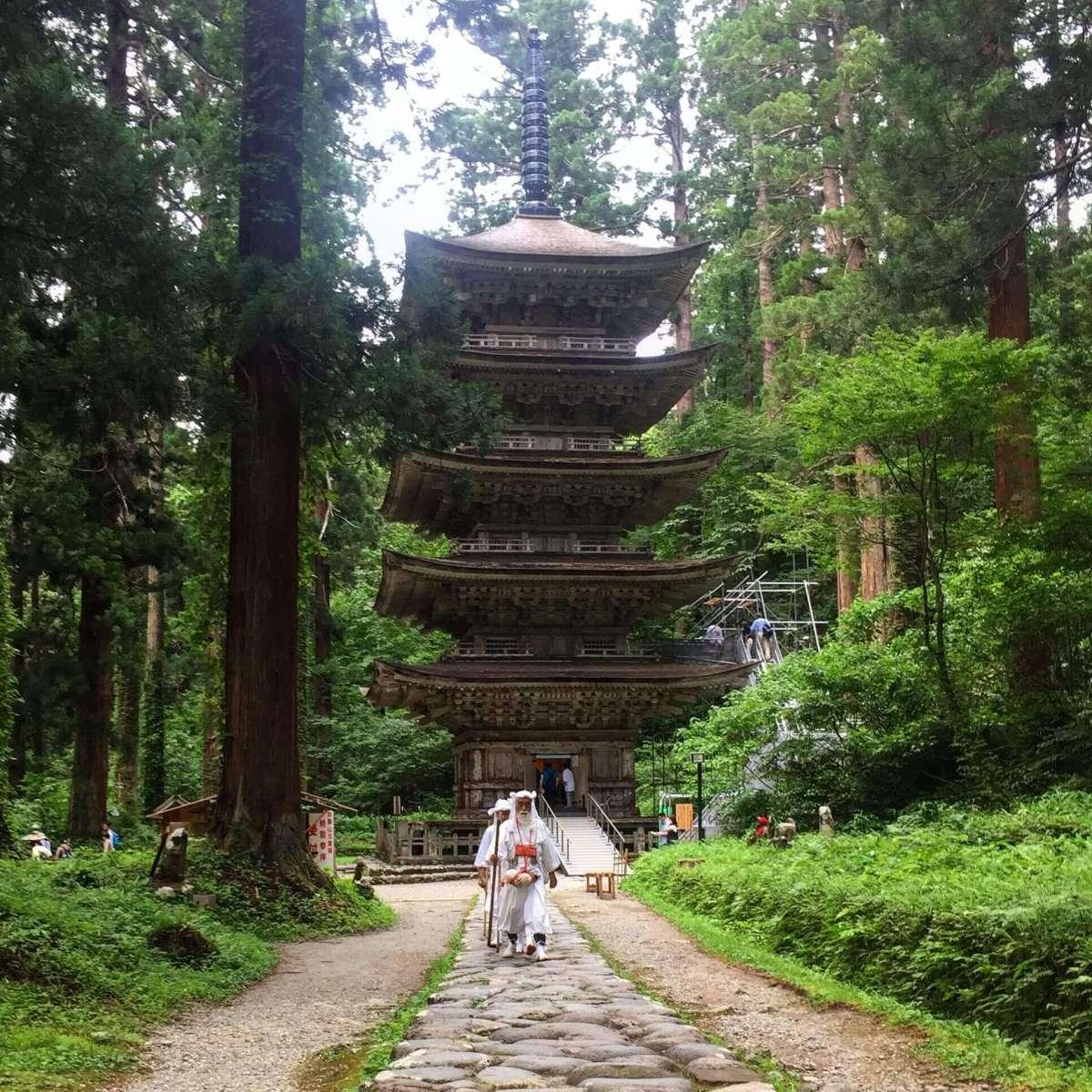 Yamabushi training near the Five Storied Pagoda on Mt. Haguro of the Dewa Sanzan