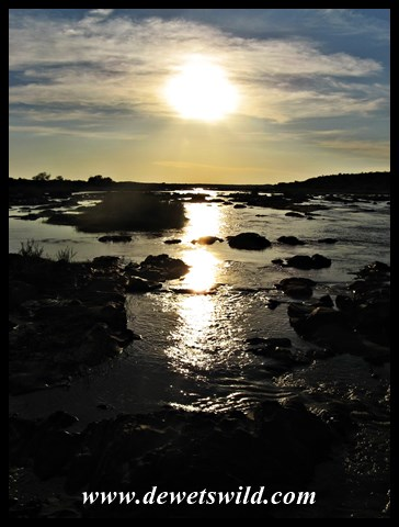 Sunrise over the Olifants from the Balule causeway