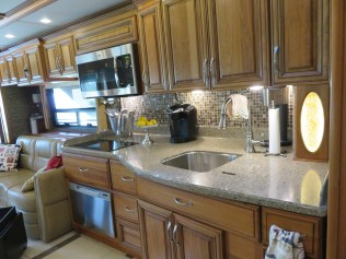 Microwave/convection oven; 2 burner cooktop; dish washer; cooking utensils; signature tray of lemons; coffee maker; double sinks (1 sink covered for increased counter space); soda stream and paper towels