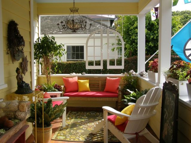 Beautiful front porch with colorful pillows