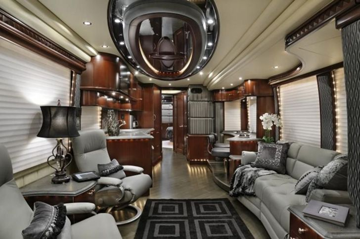 Luxury Motorhome RV Trailer Interiors with rugs and sofa - Source decoratoo