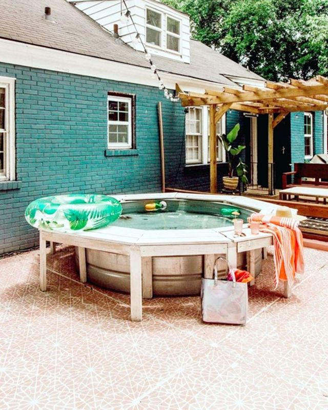 Recreational Pool With Wooden Bench Arund