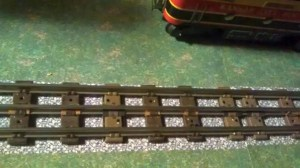 Why do Lionel trains have three rails