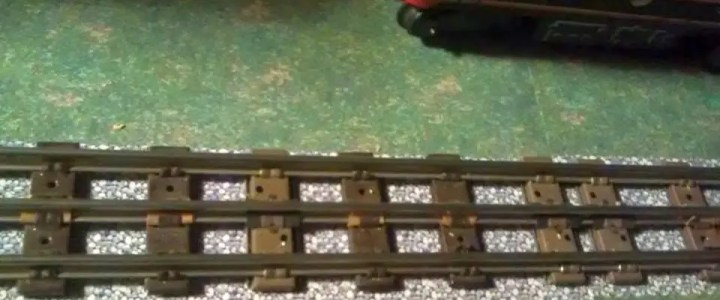 Why do Lionel trains have three rails?