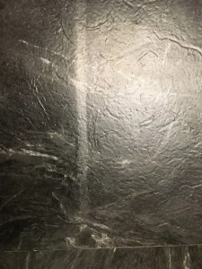 Peel and stick tile over ceramic tile