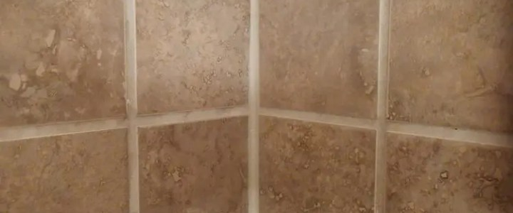 Can you caulk over grout?