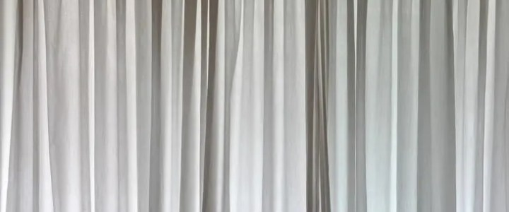 Do blackout curtains help with heat?