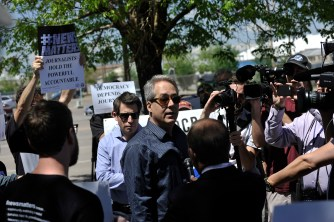 Former Denver Post editorial page editor Chuck Plunkett, center, speaks to members of the media on Tuesday, May 8, 2018 outside the paper's office and printing plant in north Denver. Photo by Patrick Traylor