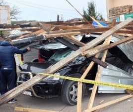 Car smashed by fallen debris