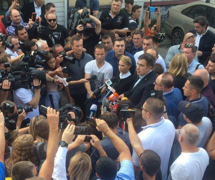 Yulia Timoshenko and Mikheil Saakashvili addressing a large crowd of journalists before boarding a train in Poland bound for Lviv, Ukraine