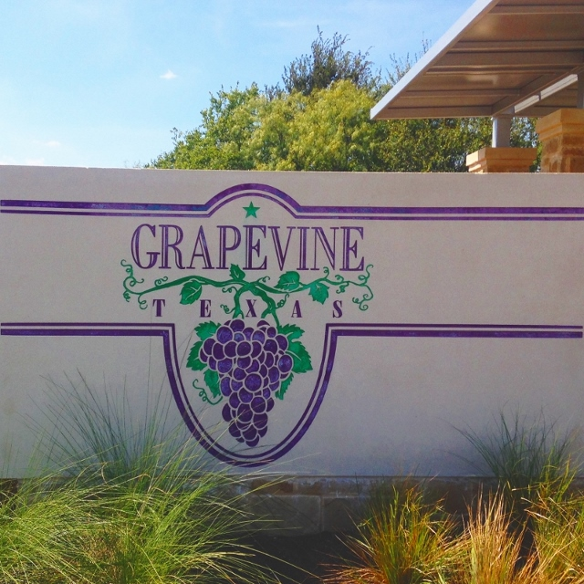 The conrete sign announcing the city limits of Grapevine, Texas.