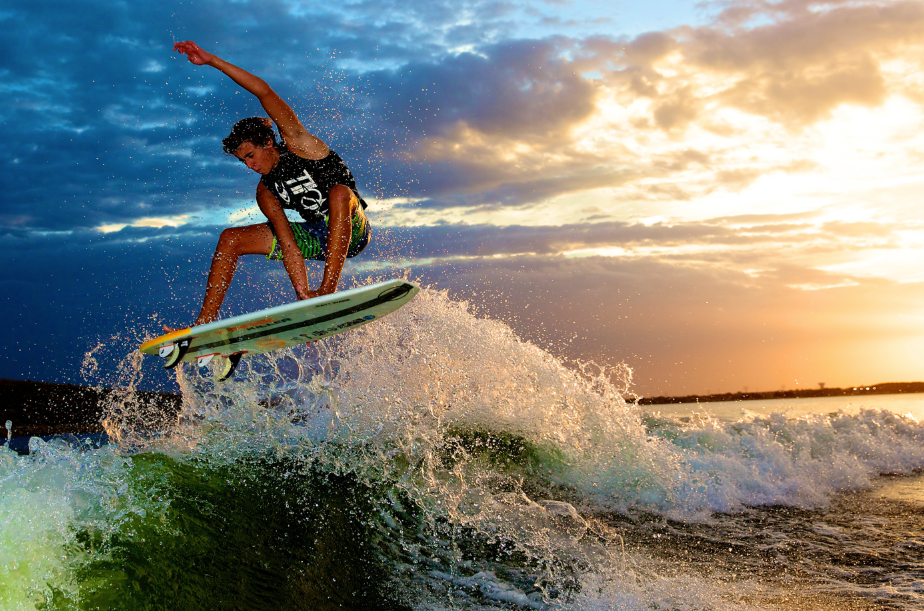 Parker Payne boosting an air during a sunset on Lake Lewisville, photo by Mark Payne