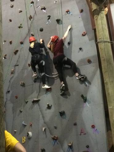 We climbed all the way to the top of this indoor rock climbing wall while being attached to each other