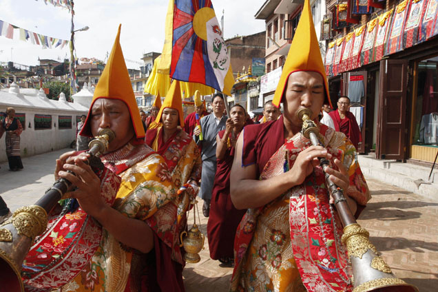 Tibetan exile monks play traditional music instruments as they take out a procession on the 48th Tibetan democracy day in Baudhanath Stupa, unseen, one of the holy Buddhist monuments in the outskirts of Katmandu, Nepal, Tuesday, Sept. 2, 2008. (AP Photo/Binod Joshi)