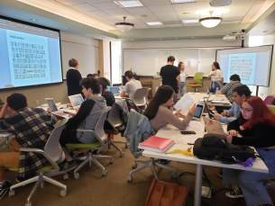 students at collaborative workstations and multiple instructors
