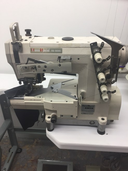 Kansai Special RX-9000 Semi Cylinder Three Needle Five Thread Sewing Machine Complete With New Table Stand and 110 volt Servo Motor.