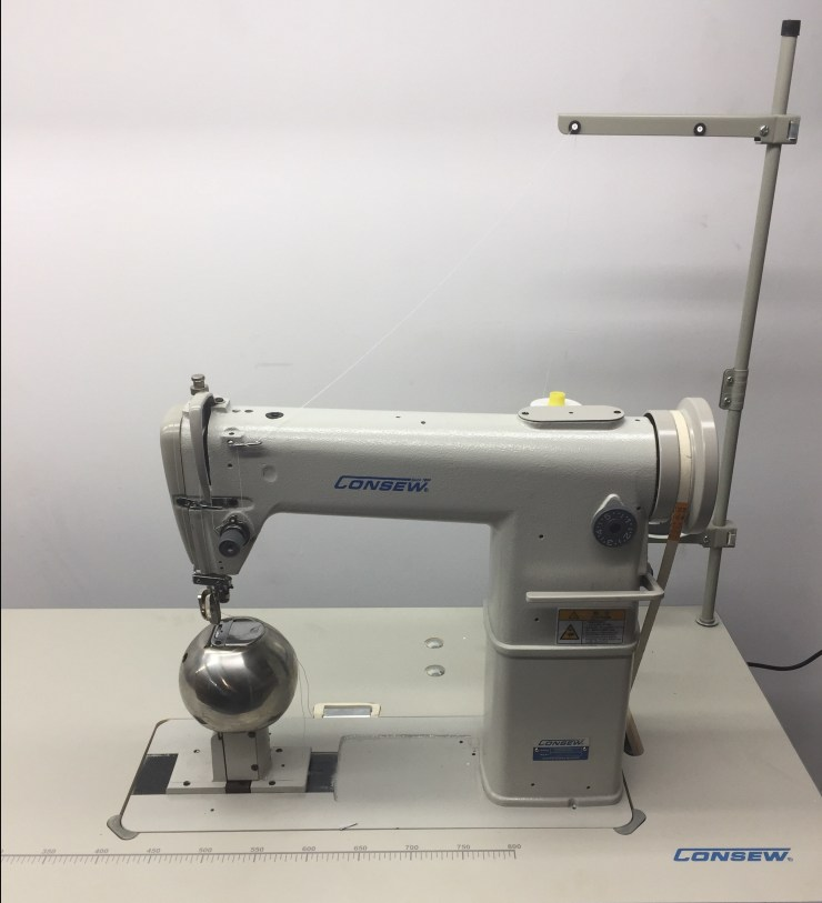 Consew 228R-Wig High Speed, Post Type, Single Needle, Drop Feed, Lockstitch Machine with special Spherical needle area for handling such items as wigs or hats