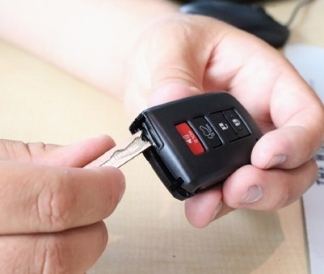 Image Showing Process Showing How To Open The Key Fob