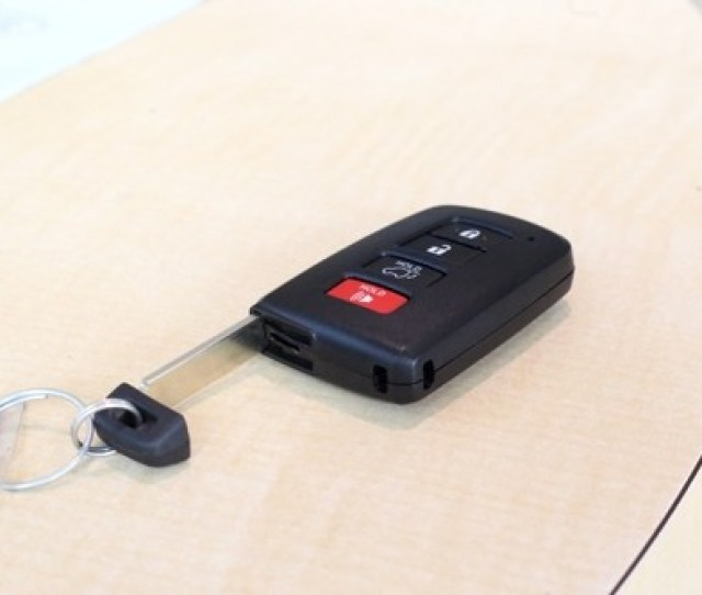 Key Fob On A Table Showing The Physical Key Housed Inside The Key Fob