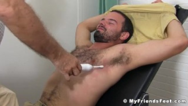 Bound hairy guy endures tickling torment while toe sucked