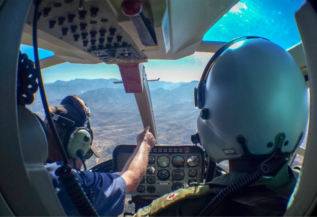 The cockpit of the Lesotho Defence Force helicopter on route