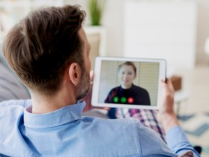 Man on video call with loved one
