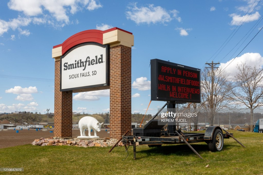 A sign outside the Smithfield Foods pork processing plant in South Dakota, one of the countrys largest known Coronavirus clusters, is seen  on April 21, 2020 in Sioux Falls, South Dakota. - Smithfield Foods pork plant in South Dakota is closed indefinitely in the wake of its coronavirus outbreak. (Photo by Kerem Yucel / AFP) (Photo by KEREM YUCEL/AFP via Getty Images)