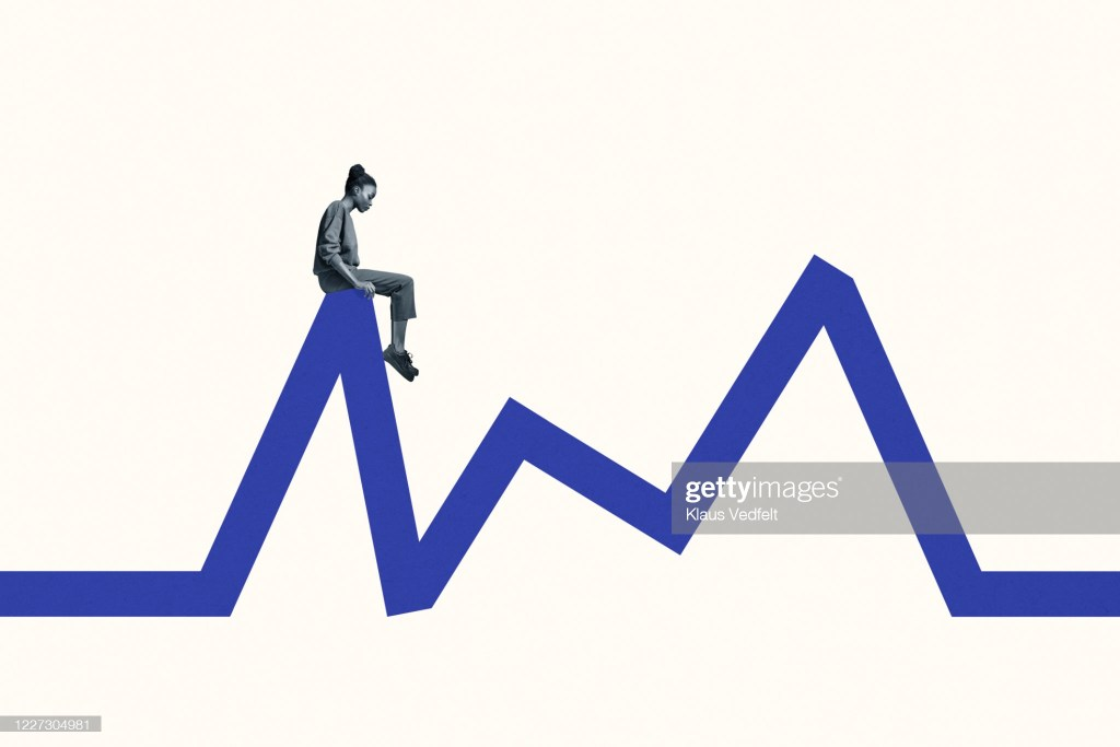 Full length side view of young woman sitting blue line graph against white background