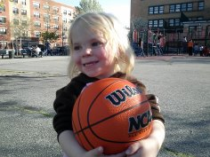 Fiona learns to dribble her basketball at the playground.