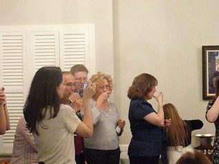 David, Ted, Jillian, and Adriane raise their glasses as Andrada takes a photo.