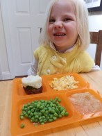 Fiona enjoys a cafeteria-style lunch during our homeschool version of preschool.