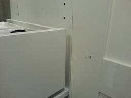 It's a shame that drawer has no space to move... It has scratched and damaged the door finish.